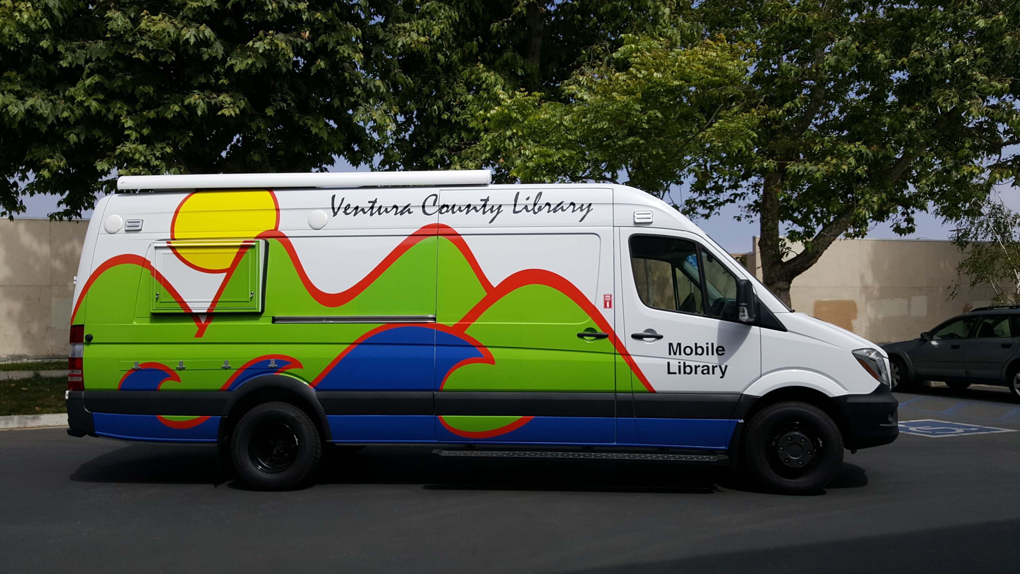 Ventura County Mobile Library photo - a large while van with the VCL mountains, sea, and sun logo on the side