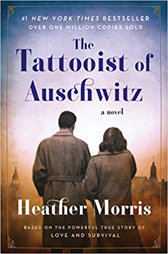 book cover for the tattooist of auschwitz. depicts the backs of a couple overlooking a city.