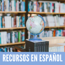 Recursos en Español - A globe in front of a library book shelf
