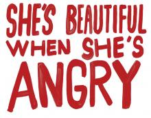 sign reading she's beautiful when she's angry painted in red